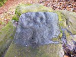 Close up of the Currer Woods Rock Carving, near Eastburn.